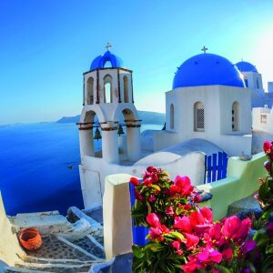Oia village in Santorini island with famous churches,  Greece