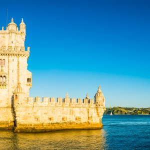 Lisbon sunset light at Belem overlooking blue Tagus panorama Portugal