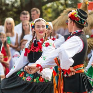 Traditional colorful folk dance group from Lowicz, Poland